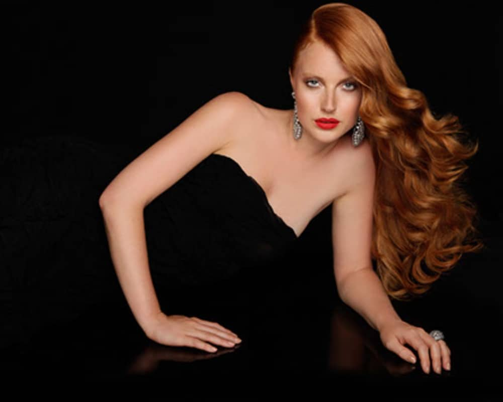 A stylish redhead haircut by Mark James Hair Studio